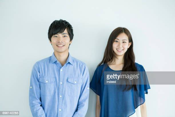 portrait of young man and woman - 上半身 ストックフォトと画像