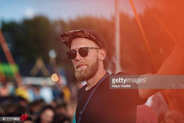 Portrait of young man at music festival