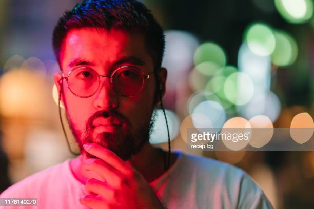 portrait of young man at night - focus on foreground stock pictures, royalty-free photos & images