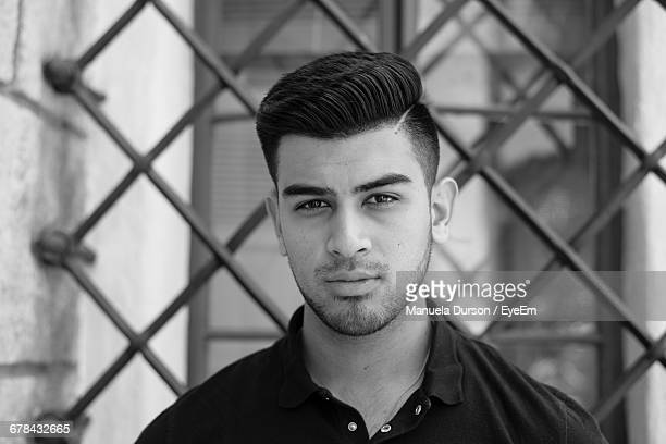 portrait of young man before building - handsome mexican men stock pictures, royalty-free photos & images