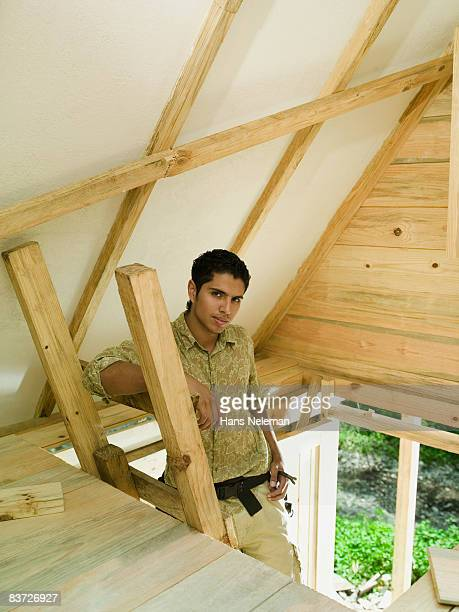 Portrait of young man building new home in forest