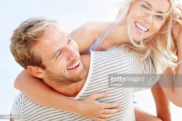 Portrait of young man giving his girlfriend a piggybackride