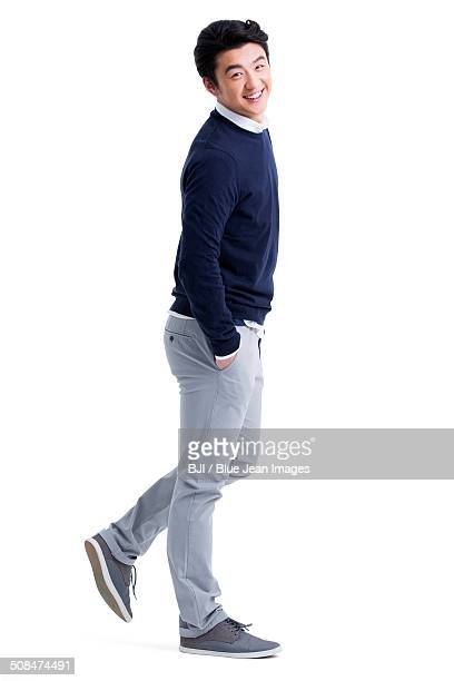 Portrait of young man hands in pockets