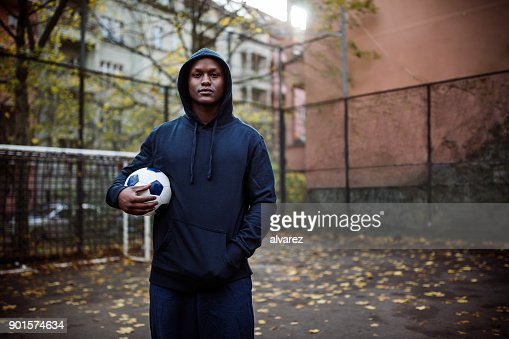 Portrait of young man holding soccer ball