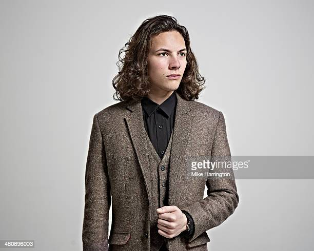 Portrait of young man in brown suit.