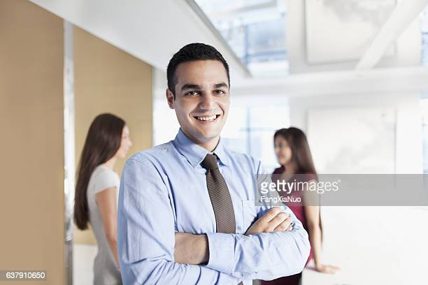 Portrait of young man in business office