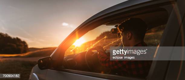 Portrait of young man in car