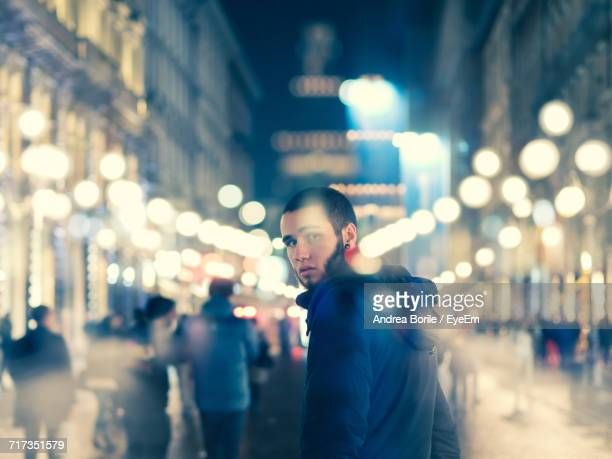 Portrait Of Young Man In City At Night