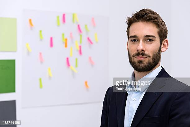 Portrait of young man in design studio