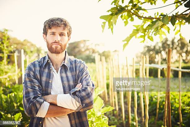 Portrait of young man in garden on sunny day