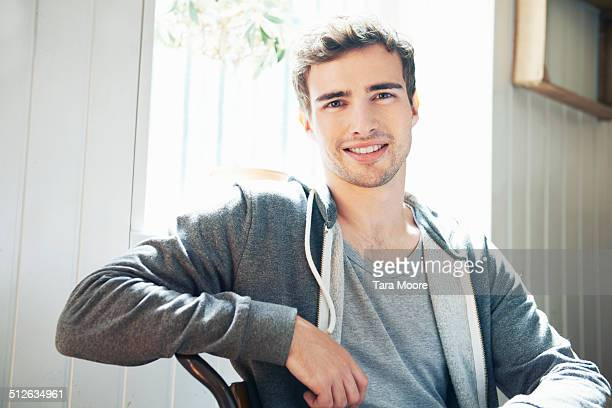 portrait of young man in house - one young man only stock pictures, royalty-free photos & images