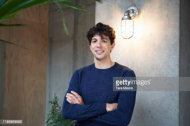 portrait of young man in office - young adult stock pictures, royalty-free photos & images