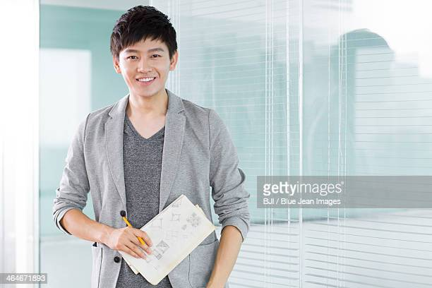 Portrait of young man in office