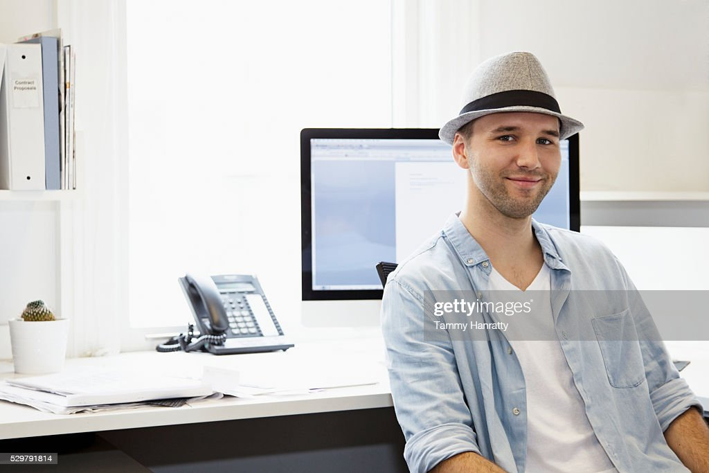 Portrait of young man in office : Bildbanksbilder
