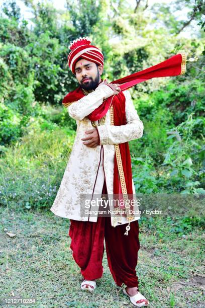 portrait of young man in traditional costume - reality kings stock pictures, royalty-free photos & images