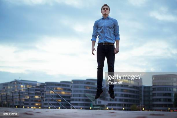 Portrait of young man jumping in the air