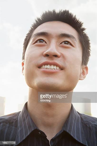 Portrait of young man looking up, Beijing