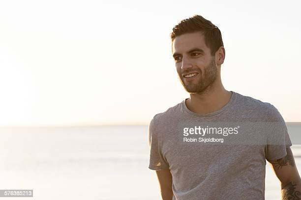 Portrait of young Man on beach smiling