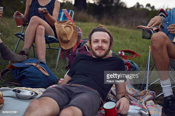 portrait of young man on camping trip - woman sitting on man's lap stock pictures, royalty-free photos & images