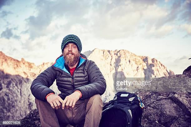 Portrait of young man on mountainside, Innsbruck, Tyrol, Austria
