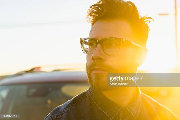 Portrait of young man, outdoors, bright sunlight