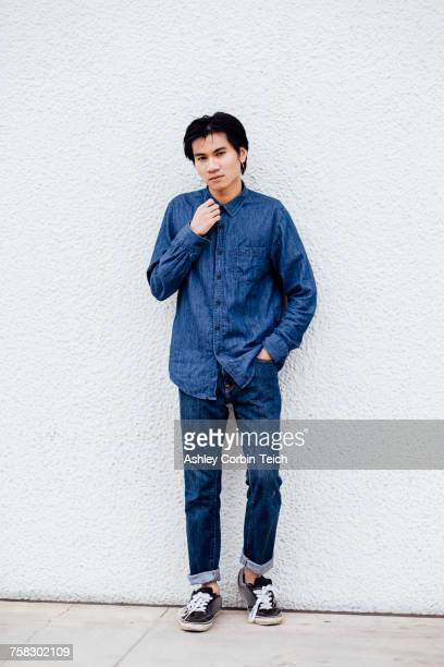 portrait of young man outdoors, wearing jeans and denim shirt - デニムシャツ ストックフォトと画像