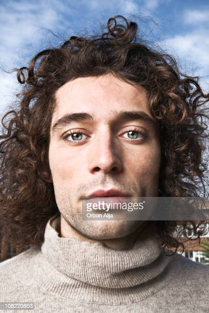 Portrait of Young Man Outside Wearing Turtle Neck Sweater