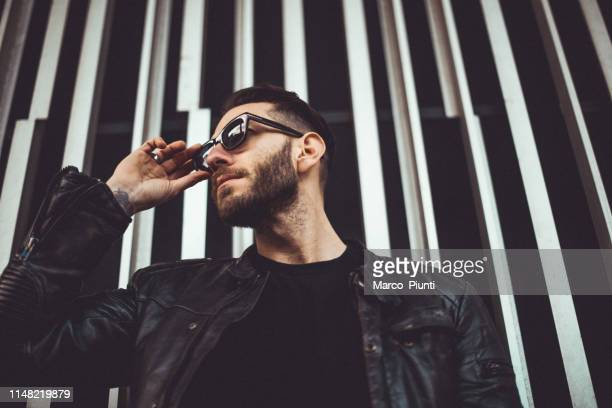 portrait of young man - leather jacket stock pictures, royalty-free photos & images