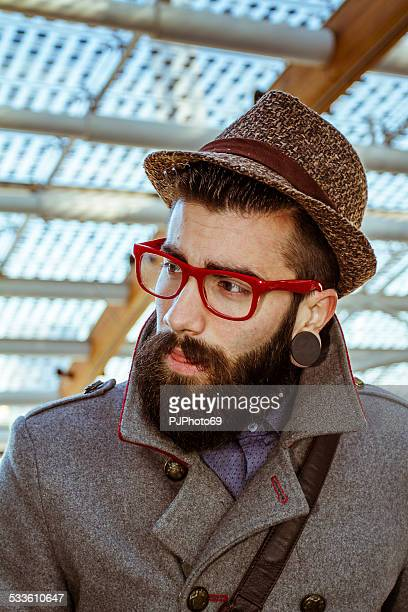 Portrait of young man (Hipster style)
