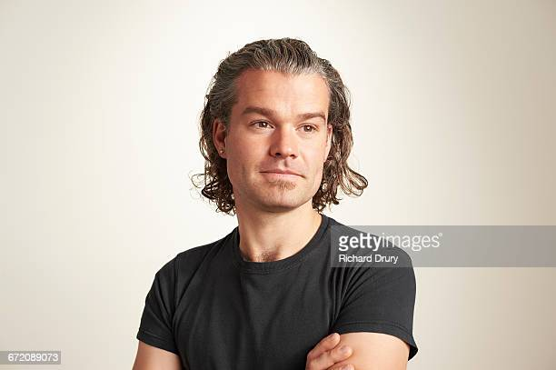portrait of young man - looking away stock pictures, royalty-free photos & images