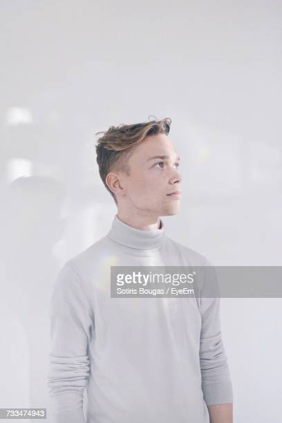 portrait of young man - high collar stock pictures, royalty-free photos & images