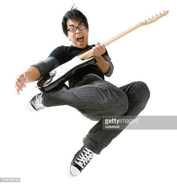 Portrait of young man playing electric guitar