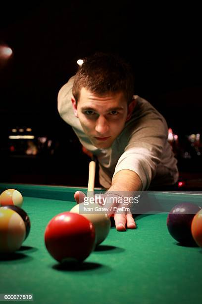 Portrait Of Young Man Playing Pool