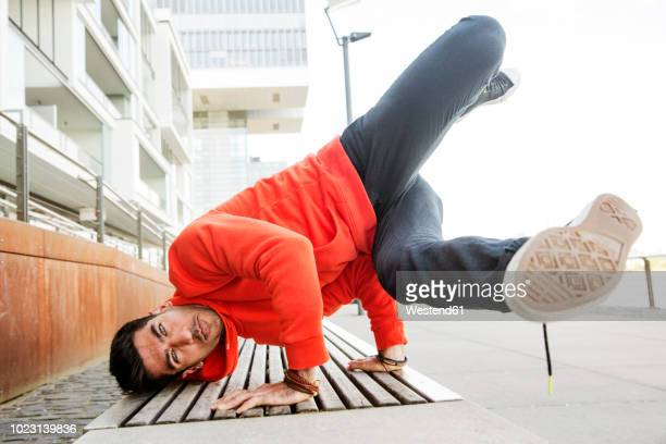 portrait of young man practicising breakdance - breakdancing stock photos and pictures