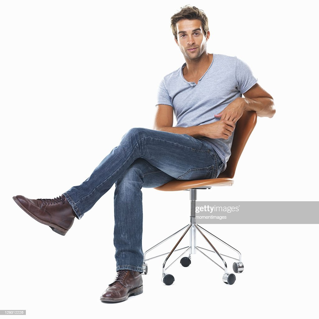 Sitting Chair: Portrait Of Young Man Sitting On Chair With Legs Crossed