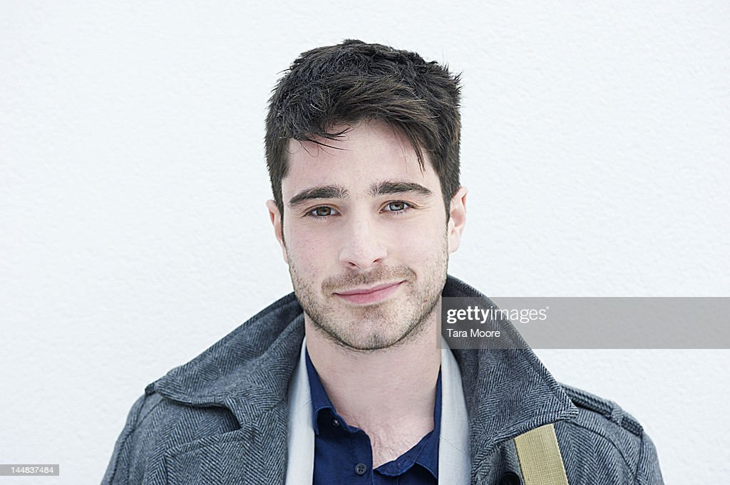 portrait of young man smiling and white background : Stock Photo