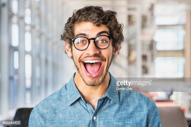 portrait of young man smiling, mouth wide open - mouth open stock pictures, royalty-free photos & images