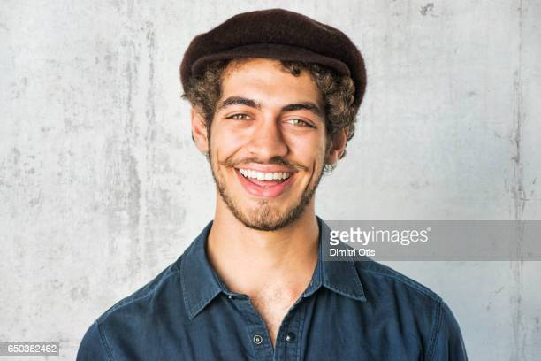 portrait of young man smiling - flat cap stock photos and pictures