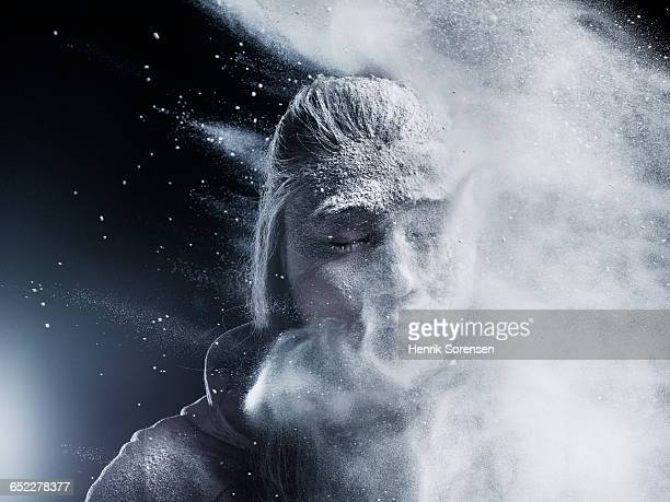 portrait of young man sprayed by powder