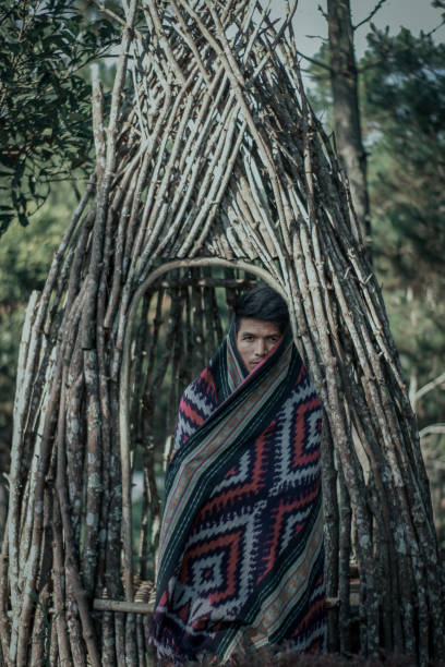 Portrait Of Young Man Standing Amidst Bamboos