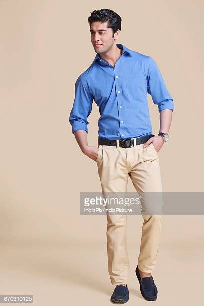 portrait of young man standing with hands in pockets - formal stock pictures, royalty-free photos & images