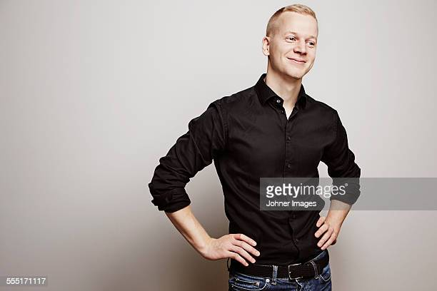 portrait of young man, studio shot - waist up stock pictures, royalty-free photos & images