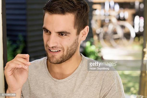 portrait of young man talking - robin skjoldborg stock pictures, royalty-free photos & images