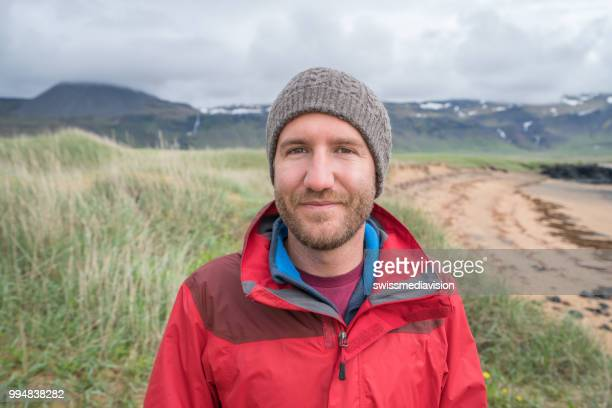 Portrait of young man tourist in Iceland