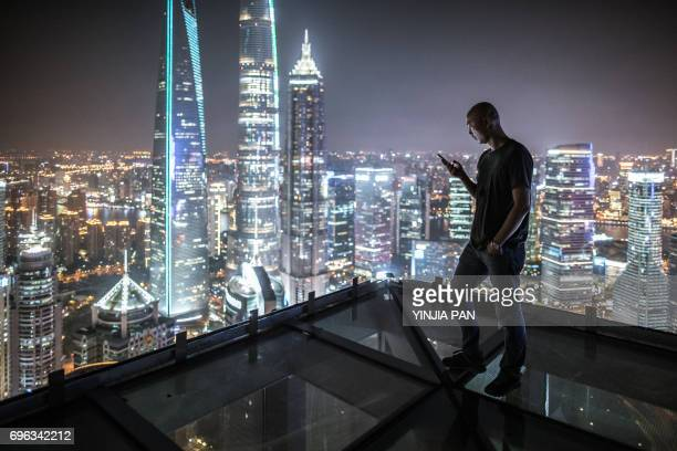 Portrait of young man watching smart phone on the roof