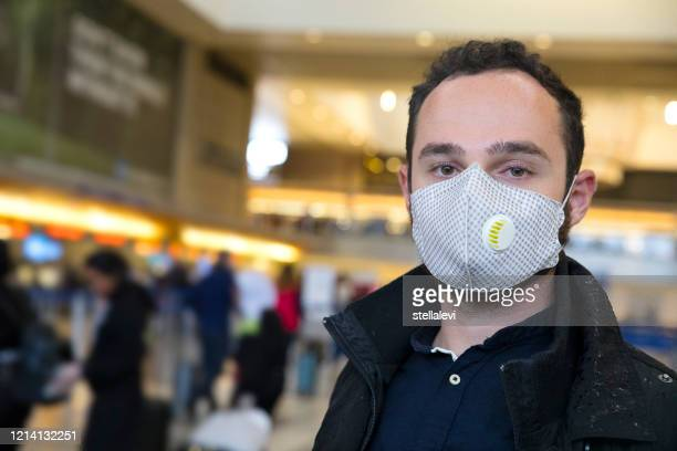 portrait of young man wearing a face mask - stellalevi stock pictures, royalty-free photos & images