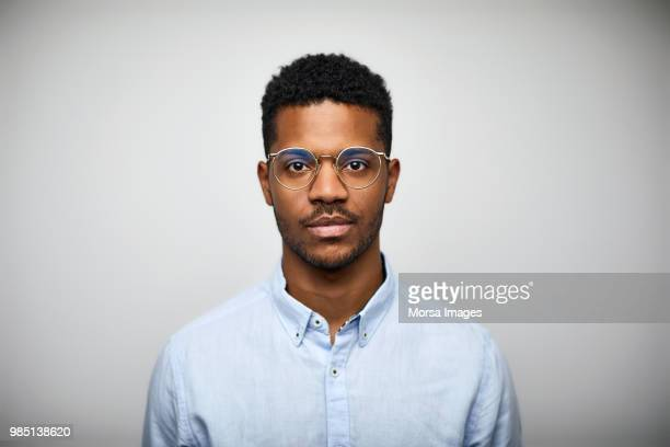 portrait of young man wearing eyeglasses - waist up stock pictures, royalty-free photos & images