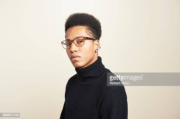 portrait of young man wearing glasses - polo neck stock pictures, royalty-free photos & images