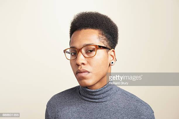 portrait of young man wearing glasses - attitude stock pictures, royalty-free photos & images