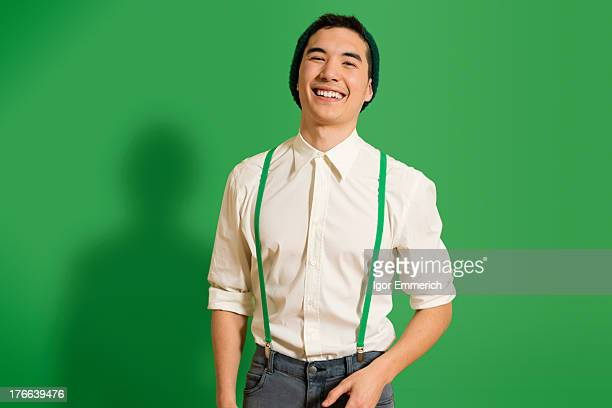 Portrait of young man wearing green braces